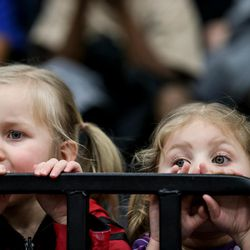 Bellamie Boyles, 3, and Emersen Boyles, 2, watch as a science experiment is conducts on the court at half time during the Salt Lake City Stars game against the Los Angeles D-Fenders at the Lifetime Activities Center in Taylorsville on Wednesday, Feb. 08, 2017.
