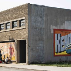 Members of the community paint over the boarded up windows of businesses near 57th Street and 7th Avenue as the city of Kenosha prepares fo the fourth day of civil unrest after police shot Jacob Blake, Wednesday evening, Aug. 26, 2020.