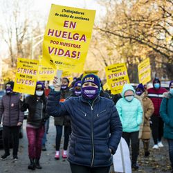 Alma Bonilla (center), 40, a dietary aid at Ambassador Nursing & Rehabilitation Center in Albany Park, leads a march of striking Infinity Healthcare Management workers outside the facility Monday.