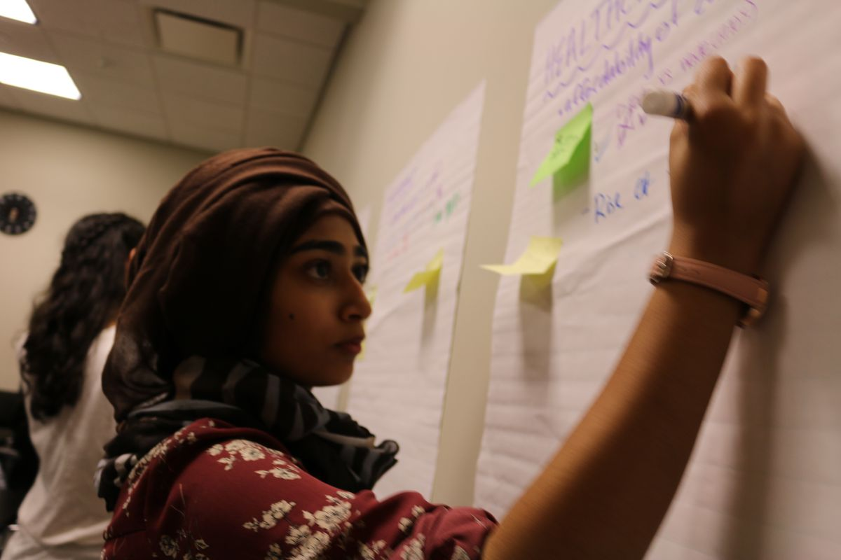 Nuzhat Wahid contributes to a brainstorming session during a recent YVote meeting.