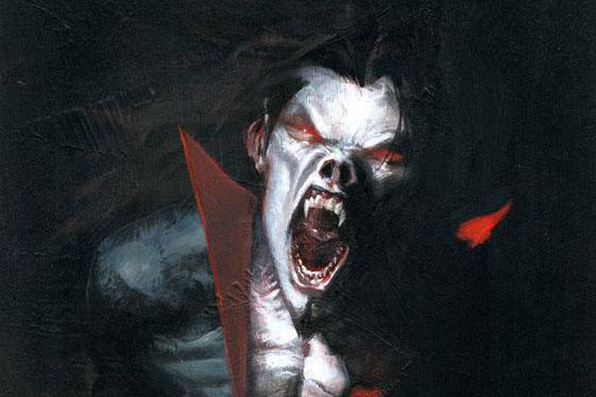 Morbius, skin pale, eyes red, fangs bared, snarls at the viewer, on the cover of Morbius: The Living Vampire #1, Marvel Comics (2013).