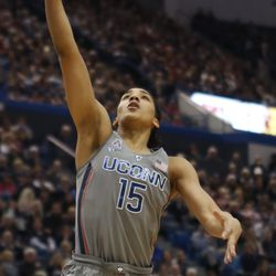 UConn's Gabby Williams (15) goes in for a layup during the Notre Dame Fighting Irish vs UConn Huskies women's college basketball game in the Women's Jimmy V Classic at the XL Center in Hartford, CT on December 3, 2017.