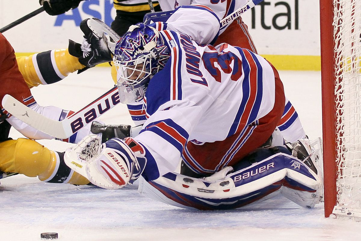 BOSTON, MA - FEBRUARY 14:  Henrik Lundqvist #30 of the New York Rangers stops a shot in the first period against the Boston Bruins on February 14, 2012 at TD Garden in Boston, Massachusetts.  (Photo by Elsa/Getty Images)