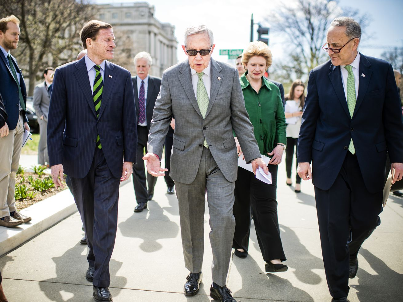 From left, Sens. Richard Blumenthal (D-CT), former Senate Minority Leader Harry Reid, Debbie Stabenow (D-MI), and Chuck Schumer (D-NY) walk to a news conference at the Supreme Court in 2016.