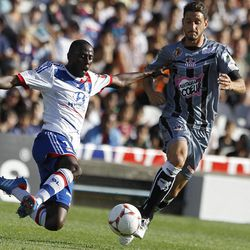 Lyon's Mouhamadou Dabo, left, challenges for the ball with Ajaccio's Jean Baptiste Pierazzi during their French League One soccer match at Gerland stadium, in Lyon, central France, Sunday, Sept. 16, 2012.