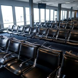 Seating is empty at a gate at Salt Lake City International Airport on Thursday, April 30, 2020. Like airports all over the world, Salt Lake's airport has seen air traffic plummet due to the COVID-19 pandemic.