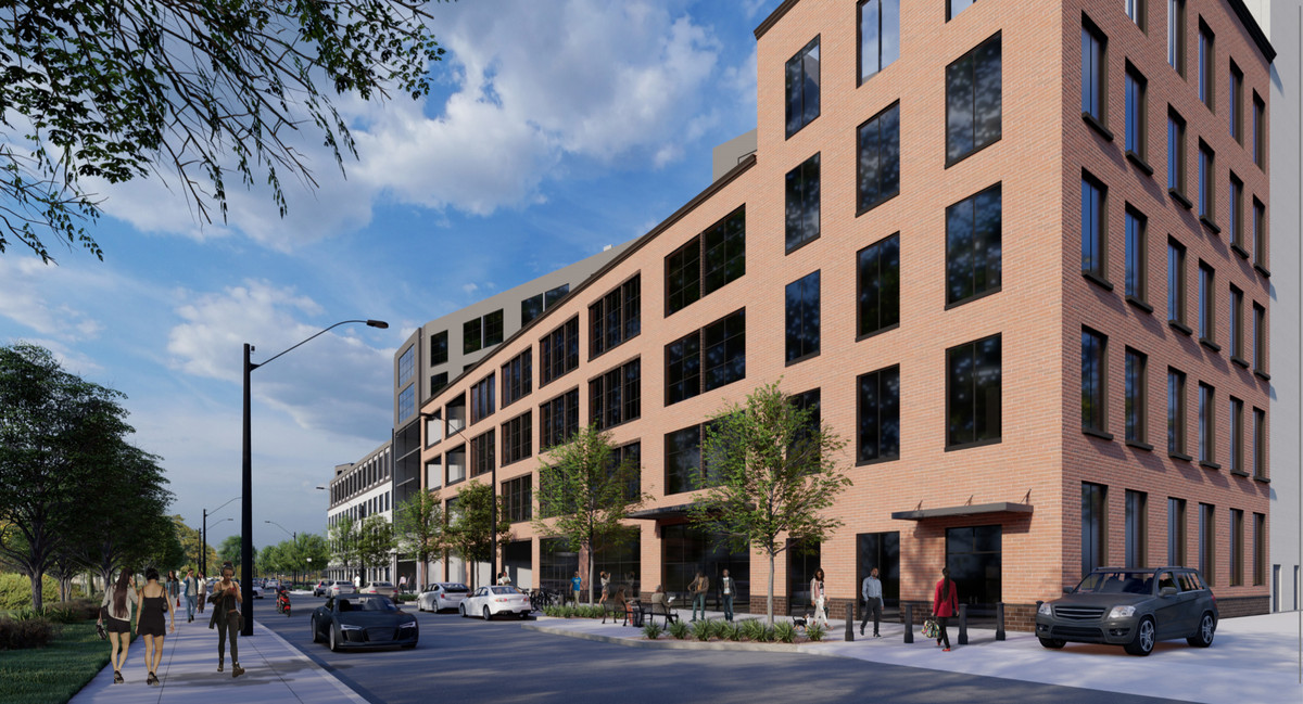 A rendering of a long brick building fronted by a sidewalk with trees and a two-way street.