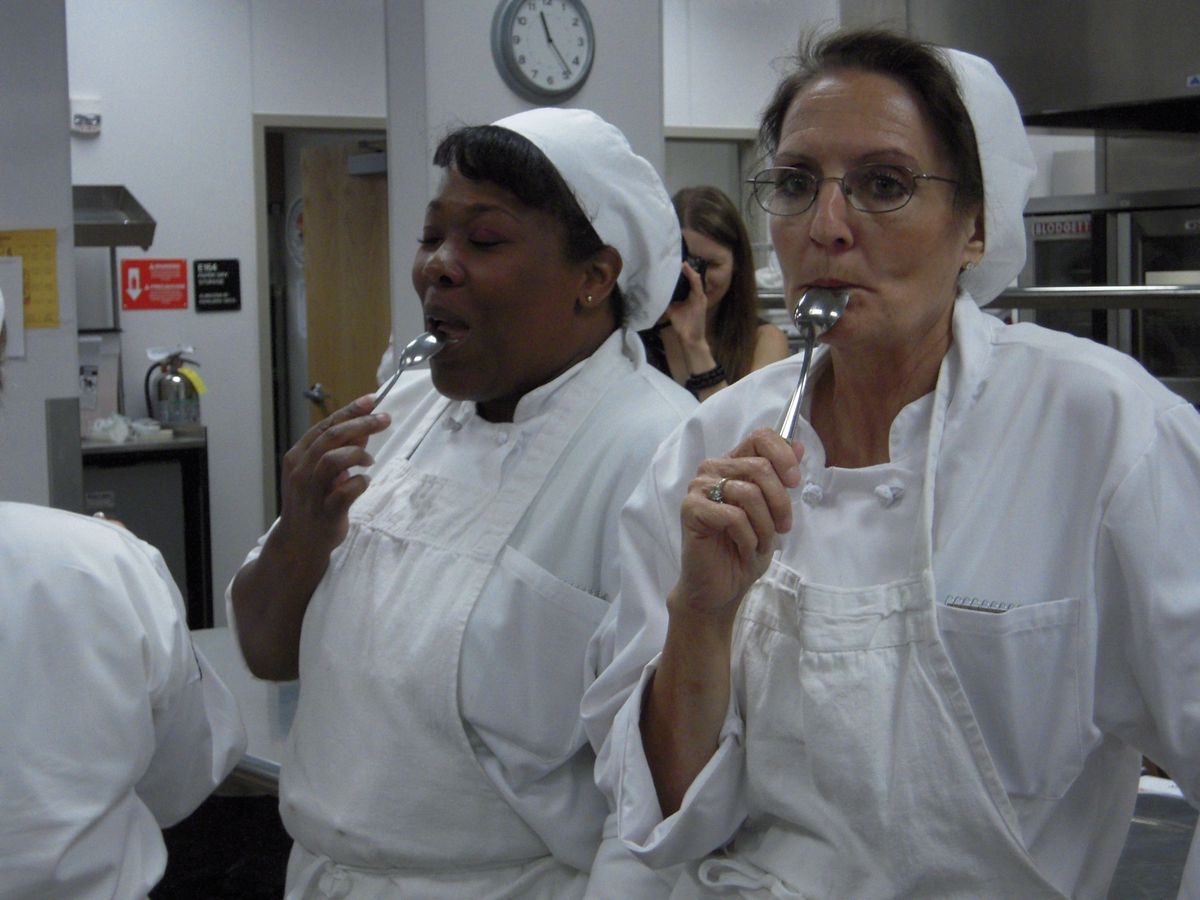 Culinary boot camp students sample the fresh mashed potatoes.