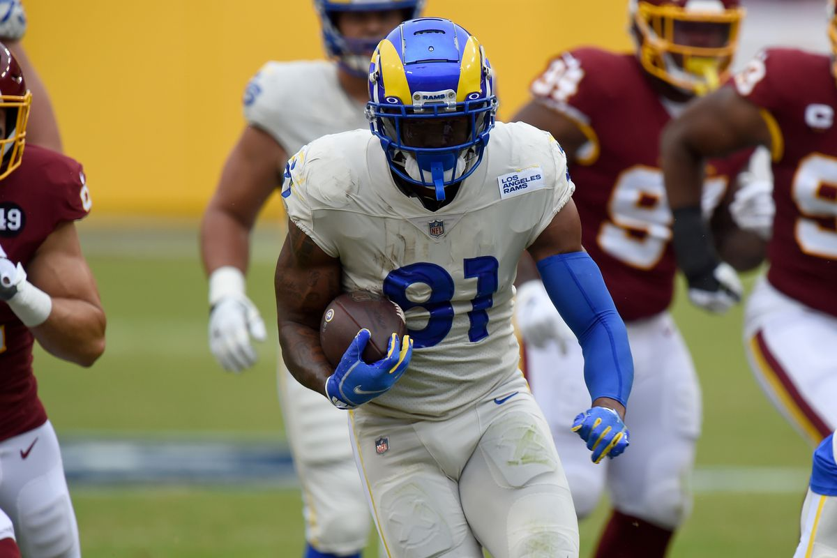 Gerald Everett #81 of the Los Angeles Rams runs with the ball after making a catch in the first quarter against the Washington Football Team at FedExField on October 11, 2020 in Landover, Maryland.