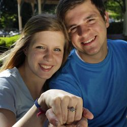 In this April 18, 2012 photo, Joe Nelson, 18, poses with his girlfriend Rebecca Leet, 17, in Collierville, Tenn. Nelson presented Leet with a ring when he asked her to the prom.