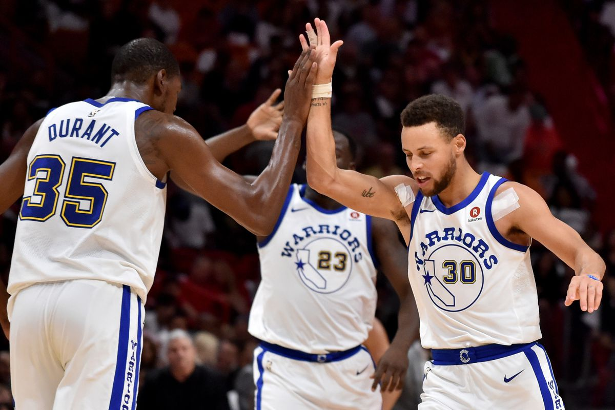 8668eb343e8d Curry s hot shooting leads the Warriors to a blowout victory over the Miami  Heat