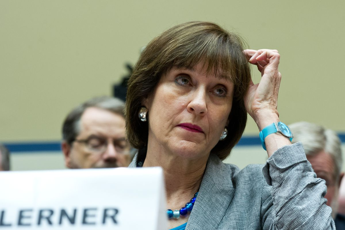 Then-IRS Director of Exempt Organizations Lois Lerner listens during testimony to the House Oversight and Government Reform Committee May 22, 2013.
