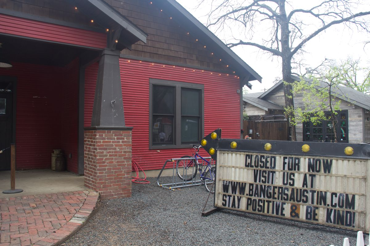 """Rainey Street restaurant and bar Banger's updated its marquee signage to read """"Closed For Now. Visit Us at www.bangersaustin.com Stay Positive & Be Kind!"""""""