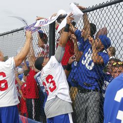 Chris Snee and Da'Rel Scott on Autograph Day. [Jim O'Connor-USA TODAY Sports]