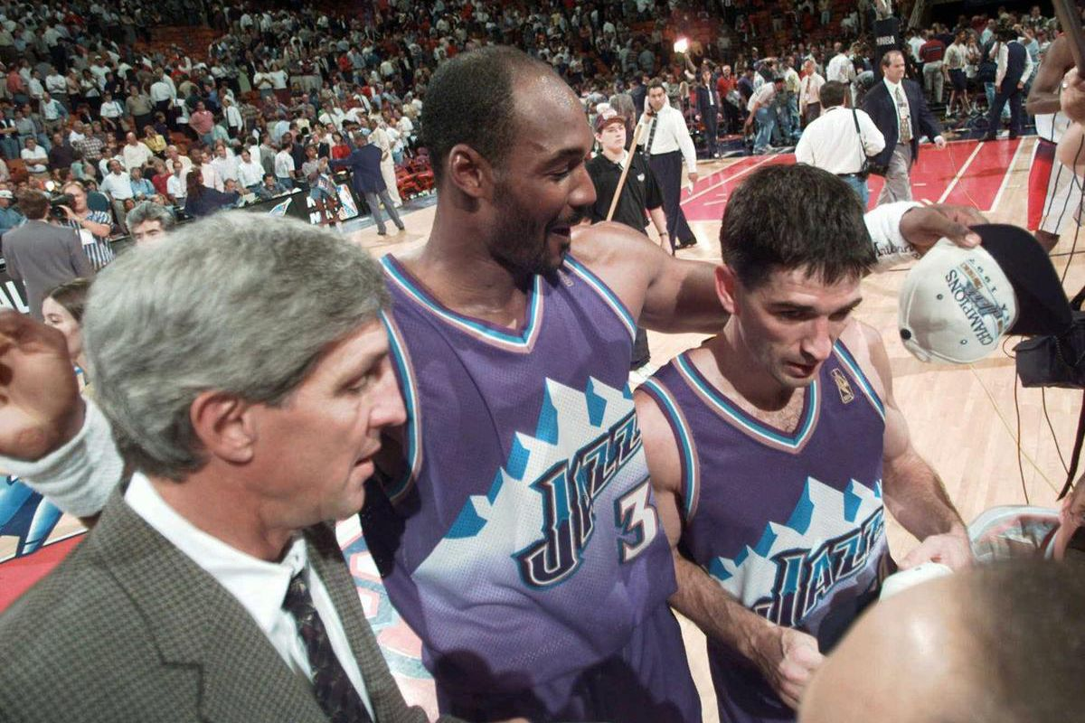 FILE: Utah Jazz's John Stockton, right, walks off the court with teammate Karl Malone, center, and coach Jerry Sloan after beating the Houston Rockets 103-100 in Game 6 of the Western Conference Finals Thursday, May 29, 1997, in Houston.