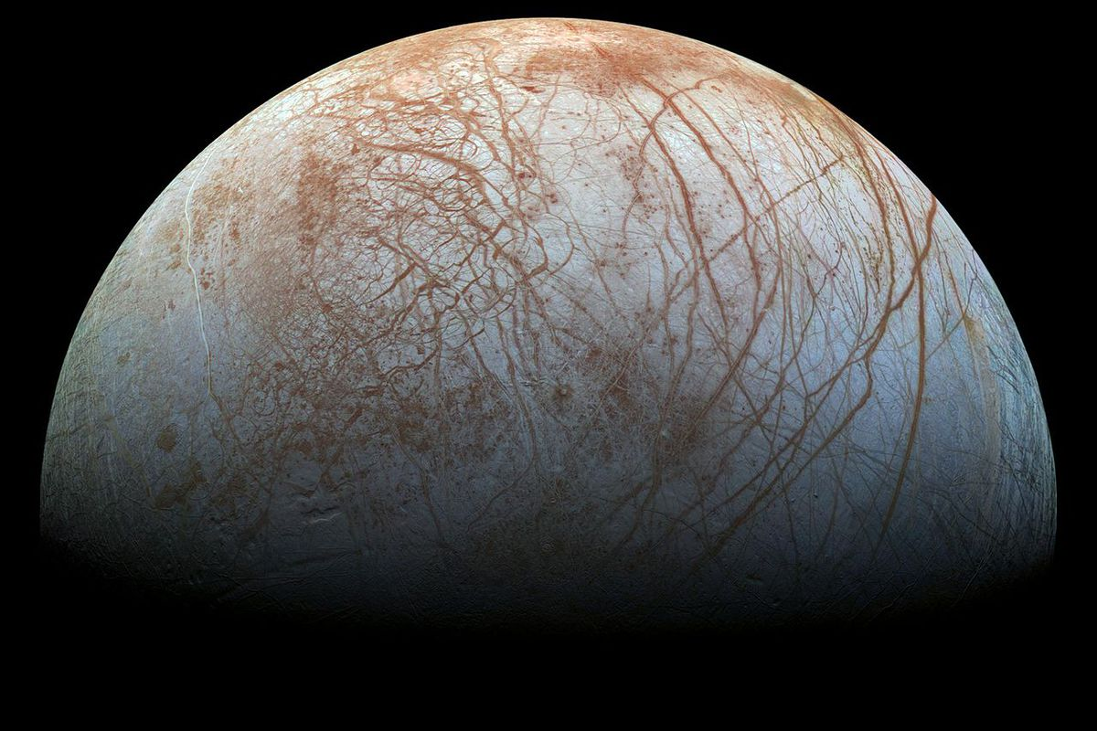Jupiter's moon Europa, which has an icy surface crisscrossed with cracks and ridges.