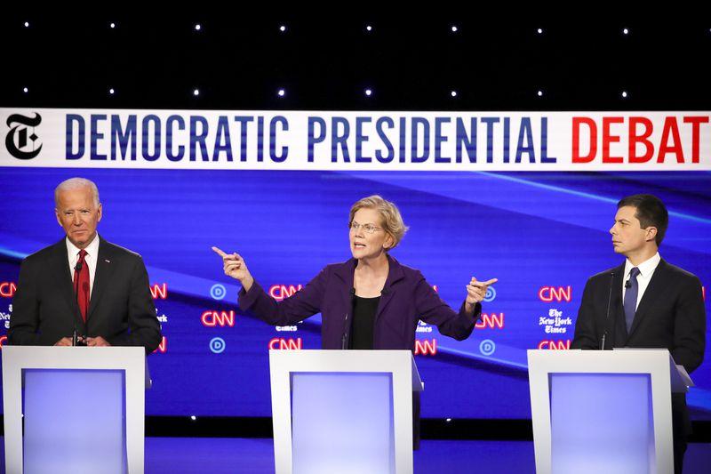 Former Vice President Joe Biden, Sen. Elizabeth Warren (D-MA) and South Bend, Indiana, Mayor Pete Buttigieg on stage during the Democratic presidential debate.
