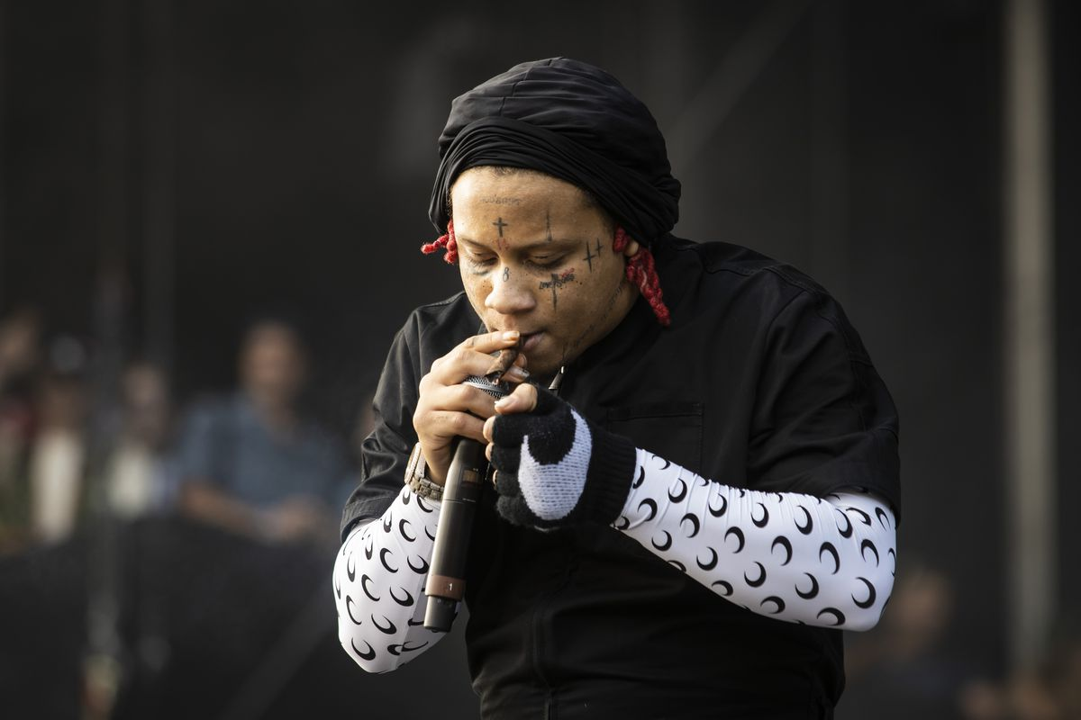 Trippie Redd smokes while he performs Saturday afternoon at Lollapalooza.