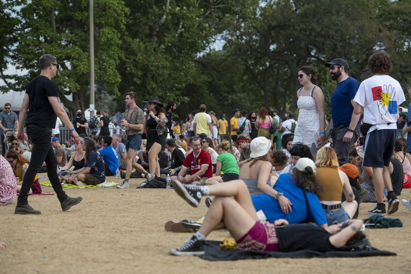 Festivalgoers lounge and walk around the field near the Green Stage at Pitchfork music festival at Union Park, Sunday, Sept. 12, 2021.