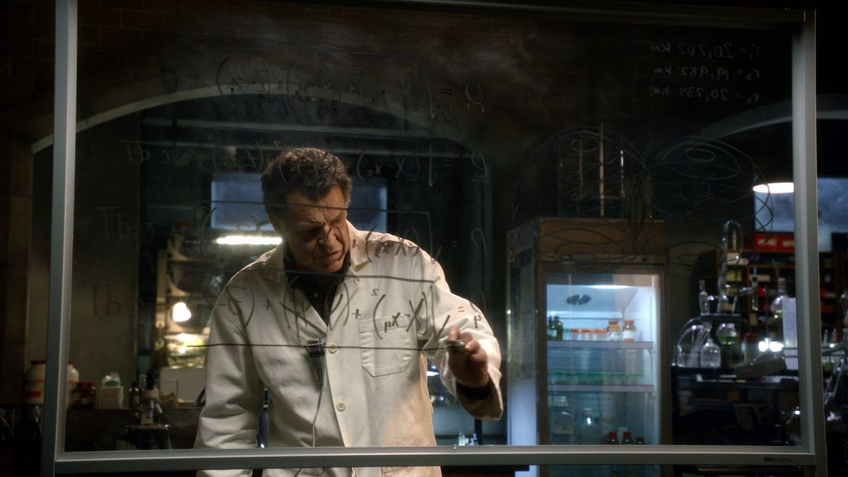 the scientist from fringe working on a math equation on a board
