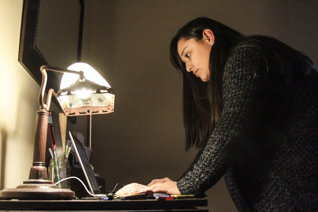 Monica Chiarelli tries to connect with her father Marco Nateras through a video call at her home in Downers Grove. | Maria Cardona / Sun-Times