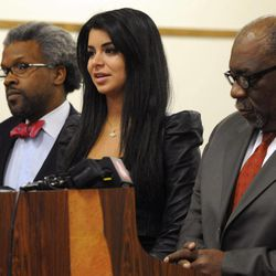 Todd Russell Perkins, left,  Highland Park City Attorney and W. Otis Culpepper, defense attorney, flank ex-Miss USA Rima Fakih as she faces DUI charges in 30th District court, before Judge Brigette Officer, in Highland Park, Mich., Wednesday, April 11, 2012.  Fakih pleaded no contest Wednesday in a Michigan drunken driving case. The former beauty queen offered the plea to driving while visibly impaired. A no contest plea isn't an admission of guilt but is treated as such for sentencing, which will take place May 9. She faces a maximum of 93 days in jail.