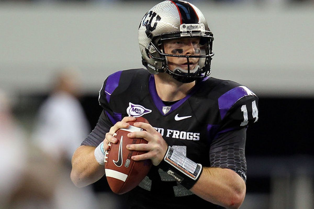 ARLINGTON TX - SEPTEMBER 04:  Quarterback Andy Dalton #14 of the TCU Horned Frogs drops back to pass against the Oregon State Beavers at Cowboys Stadium on September 4 2010 in Arlington Texas.  (Photo by Ronald Martinez/Getty Images)