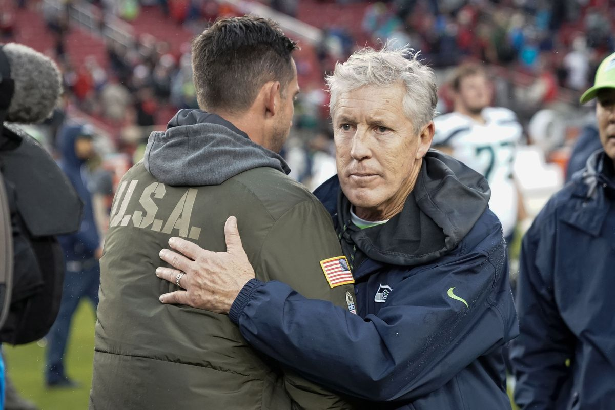 San Francisco 49ers head coach Kyle Shanahan and Seattle Seahawks head coach Pete Carroll shake hands after the game at Levi's Stadium.