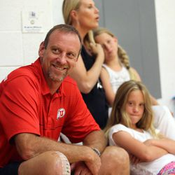 Larry Krystkowiak, head coach for the Utah Runnin' Utes basketball team, watches his sons play in a Team Camp basketball tournament with his wife Jan, and daughters Sam and Finley at the University of Utah in Salt Lake City on Friday, June 12, 2015.