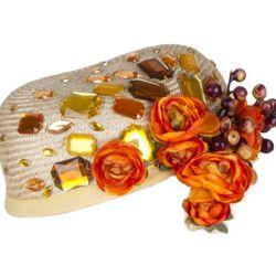 Straw pillbox with grosgrain trim, faux flowers, and rhinestones, $240