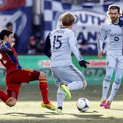 RSL's Tony Beltran tries to kick the ball away from Sporting's Seth Sinovic as Real Salt Lake and Sporting KC play Saturday, Dec. 7, 2013 in MLS Cup action.