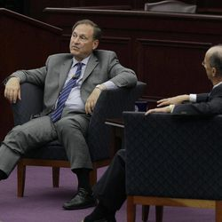 United States Supreme Court Associate Justice Samuel A. Alito, Jr., left, participates in a fireside chat event with the Honorable Ronald A. Cass at Roger Williams University Law School in Bristol, RI., Friday, Sept. 14, 2012.