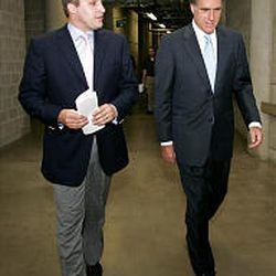Spencer Zwick, left, speaks with candidate Mitt Romney during a fund-raising visit to Salt Lake City.