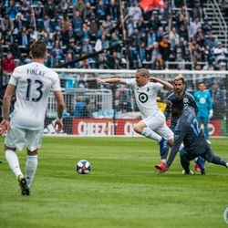 Ozzie Alonso avoids a tackle during the inaugural match at Allianz Field