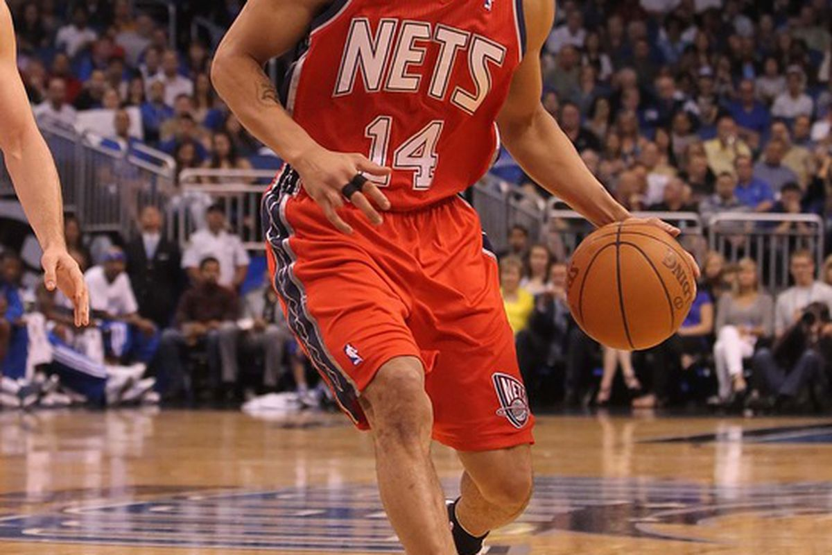 March 16, 2012; Orlando FL, USA; New Jersey Nets shooting guard Gerald Green (14) dribbles the ball during the first half against the Orlando Magic at Amway Center. Mandatory Credit: Kim Klement-US PRESSWIRE