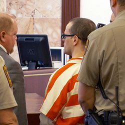 Logan Welles McFarland, pictured in an orange and white jumpsuit, pleaded guilty Wednesday, Jan. 25, 2017, to two counts of first-degree felony aggravated murder. McFarland was sentenced by 6th District Judge Marvin Bagley to two consecutive terms of life in prison without the possibility of parole.