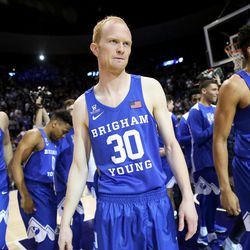 Brigham Young Cougars guard TJ Haws (30) and teammates take the court to face the Utah Utes at the Marriott Center in Provo on Saturday, Dec. 16, 2017.