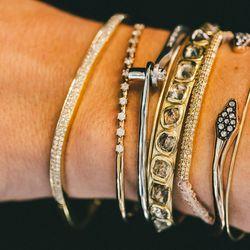 Anita Ko bracelet, $10,000; Sara Weinstock bracelet, $2,680; Borgioni bracelet, $6,900; Aida Bergsen bracelet, $2,915; Inez & Vinoodh bracelet, $3,490; Broken English bracelet, $5,600; Brooke Gregson bracelet, $2,440; Aida Bergsen bracelet, $2,915