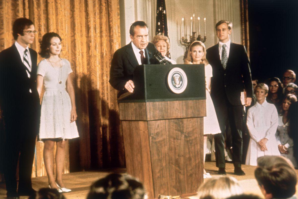 Richard Nixon speaking from behind a podium.