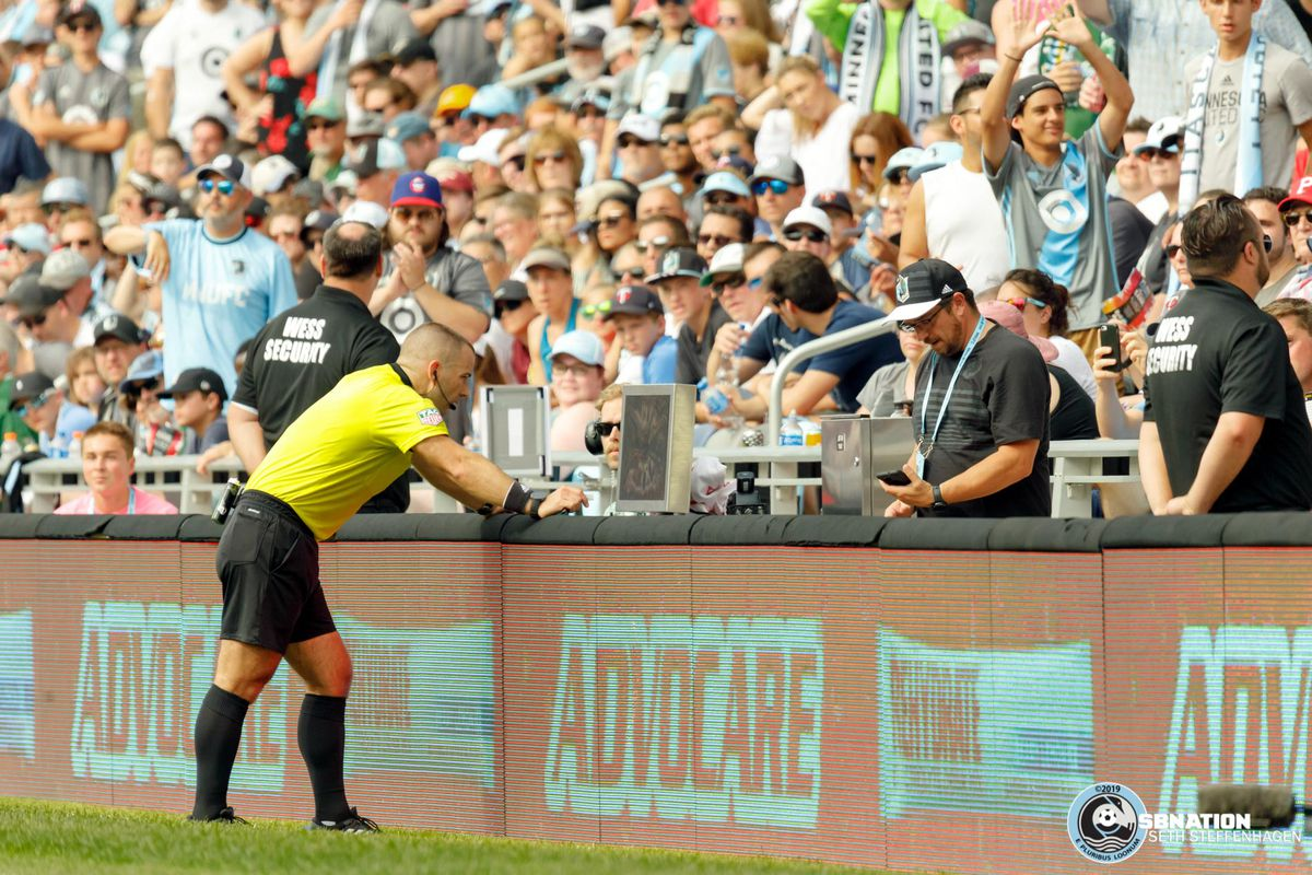 August 4, 2019 - Saint Paul, Minnesota, United States - Referee Chris Penso utilizes the VAR after a handball in the box by Portland Timbers defender Larrys Mabiala (33) during the match at Allianz Field.