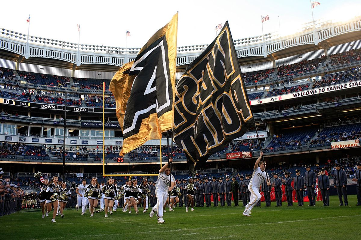 NEW YORK, NY - NOVEMBER 12:  Members of the Army Black Knights run onto the field before a game against Rutgers Scarlet Knights at Yankee Stadium on November 12, 2011 in the Bronx borough of New York City.  (Photo by Patrick McDermott/Getty Images)