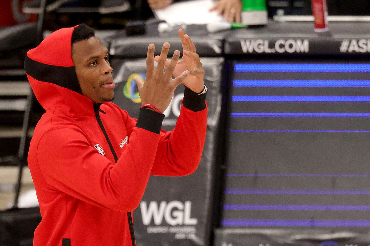 Russell Westbrook of the Washington Wizards reacts during a timeout during a preseason game against the Detroit Pistons at Capital One Arena on December 19, 2020 in Washington, DC.