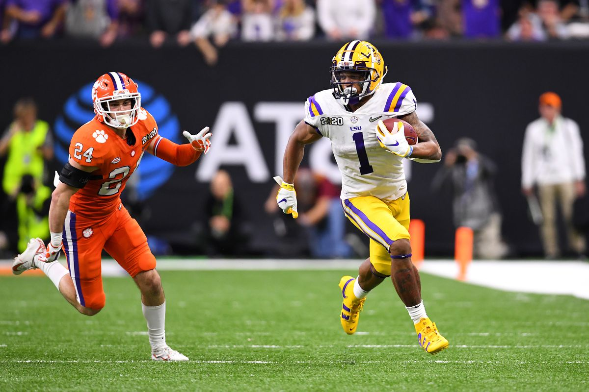Ja'Marr Chase #1 of the LSU Tigers races past Nolan Turner #24 of the Clemson Tigers during the College Football Playoff National Championship held at the Mercedes-Benz Superdome on January 13, 2020 in New Orleans, Louisiana.