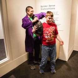 Brendan Nelson, 10, tries on the Spider Sense suit. | James Foster/For the Sun-Times