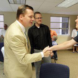 Former state Sen. Dan Liljenquist talks with Josh Pierce prior to speaking to pastors at the Salt Lake Christian Center in Salt Lake City  Tuesday, June 12, 2012.