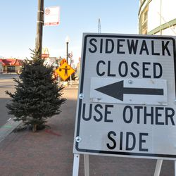 The sidewalk on the east side of Clark north of Addison is now closed