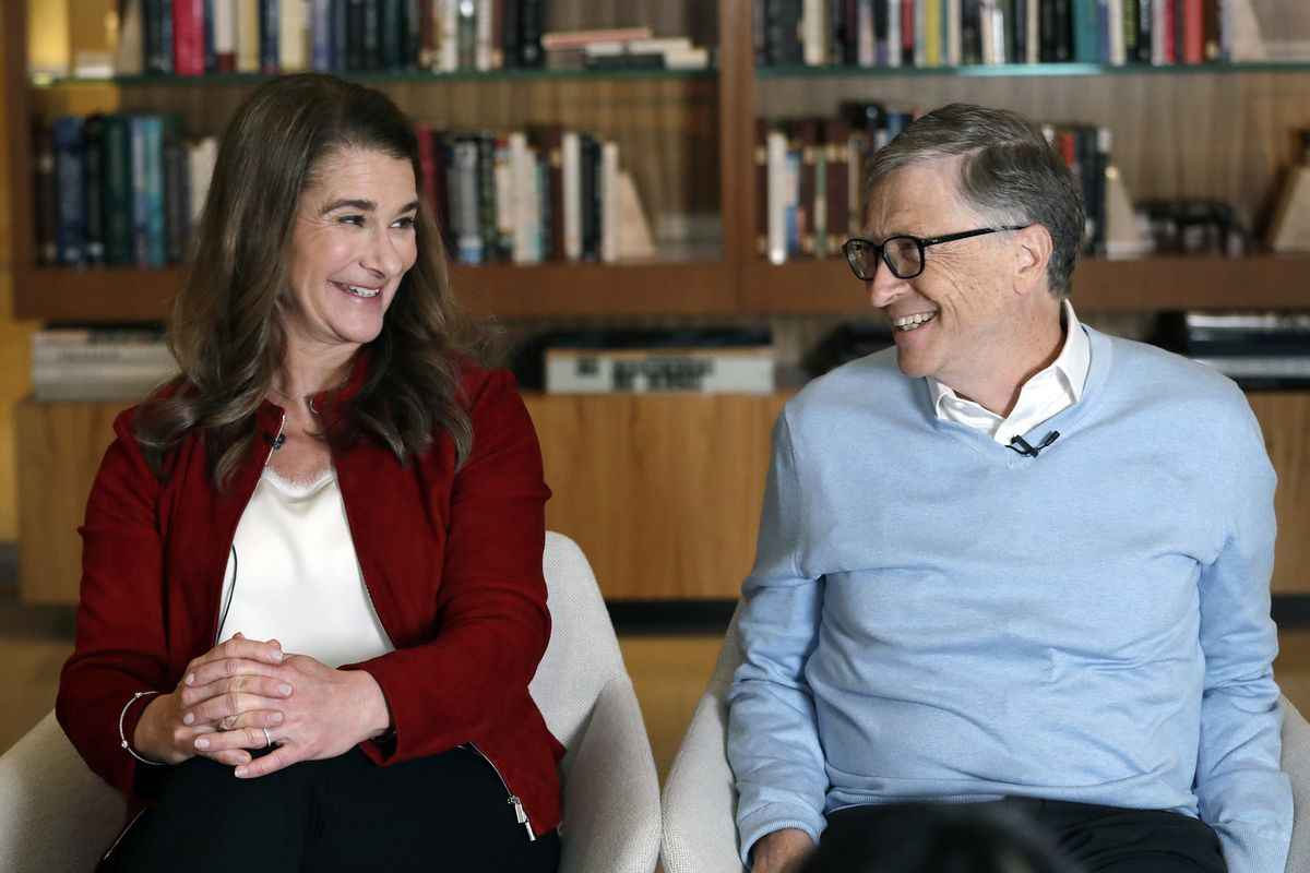Bill and Melinda Gates look toward each other and smile while being interviewed in Kirkland, Wash.
