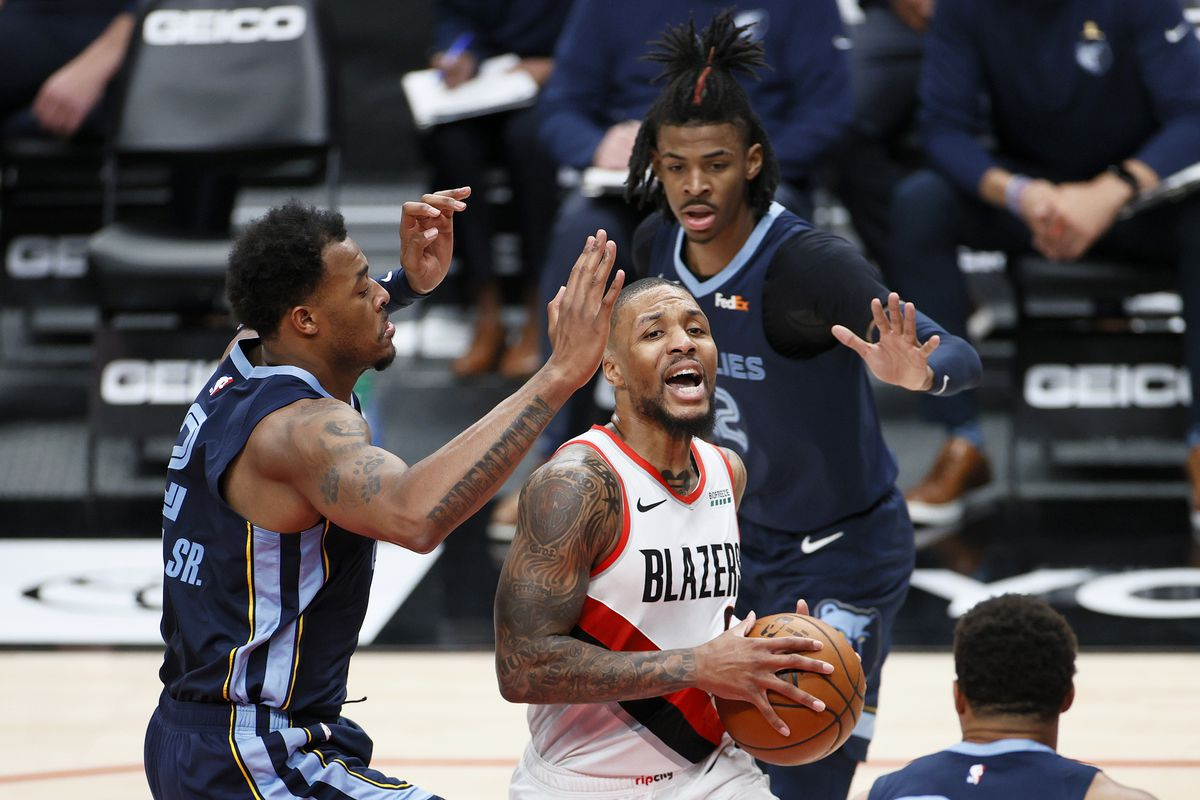 Damian Lillard of the Portland Trail Blazers drives to the basket against the Memphis Grizzlies during the first quarter at Moda Center on April 25, 2021 in Portland, Oregon.