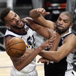 Utah Jazz center Rudy Gobert, left, blocks a pass intended for Los Angeles Clippers forward Nicolas Batum during the second half of Game 3 of a second-round NBA basketball playoff series Saturday, June 12, 2021, in Los Angeles.