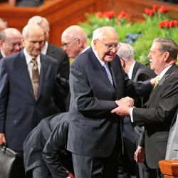 Elder L. Tom Perry, center, and Elder Jeffrey R. Holland talk at the end of the final session of the 185th Annual General Conference of The Church of Jesus Christ of Latter-day Saints Sunday, April 5, 2015, in Salt Lake City.